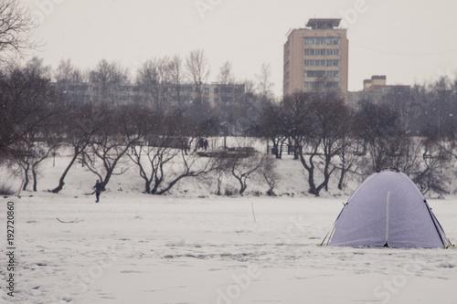 Photo Winter fishing at sea. Tents, snow, sea.
