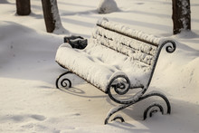 The Bench Is Covered With Snow.