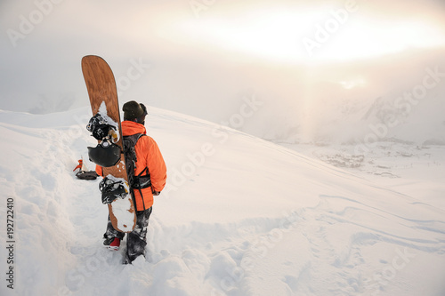 Poster Winter sports Back view of snowboarder looking on mountain peaks