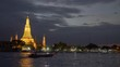 Night view of Wat Arun temple in Bangkok, Thailand, on the west bank of the Chao Phraya River. Panning shot