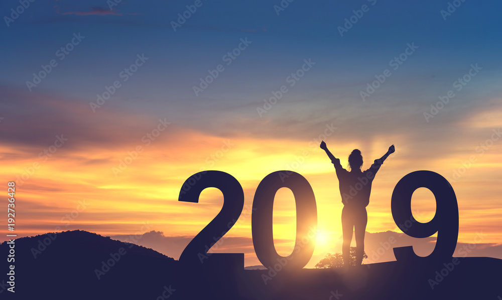 Fototapeta Silhouette freedom young woman Enjoying on the hill and 2019 years while celebrating new year, copy spce.