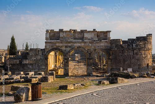 Fototapeta Ruins of Appollo temple with fortress at back in ancient Corinth, Peloponnese, G