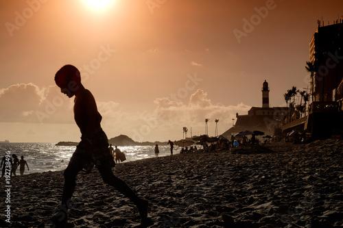 Fotografie, Obraz  Beach life on an urban beach in Salvador de Bahia, Brazil just before sunset