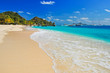 Wonderful tropical beach with boats in distance, Palm island, Caribbean region of Lesser Antilles
