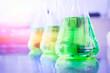 Green chemicals in beaker.
