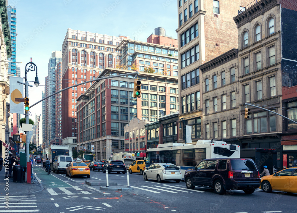 Fototapety, obrazy: City Life and traffic on Manhattan avenue ( Ladies' Mile Historic District) at daylight , New York City, United States. Toned image.