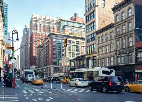 Foto op Plexiglas New York City Life and traffic on Manhattan avenue ( Ladies' Mile Historic District) at daylight , New York City, United States. Toned image.