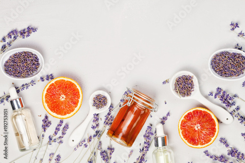Fotobehang Spa Orange and lavender body care products. Aromatherapy, spa and natural healthcare concept