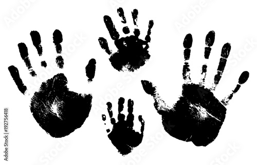 Fototapeta  Handprints of a man, a woman, a child