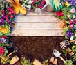 Leinwandbild Motiv Gardening Frame - Tools And Flowerpots On Wooden Table And Dirt