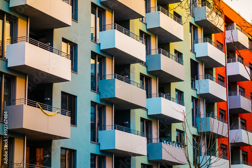 colorful apartment building with block formed balcony