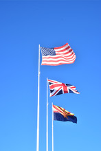 Three Flags: USA. UK, Arizona State Flag Flying On Flag Poles