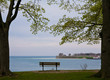 A bench at the water's edge in Queen's Royal Park, NIagara Falls, Ontario, Canada