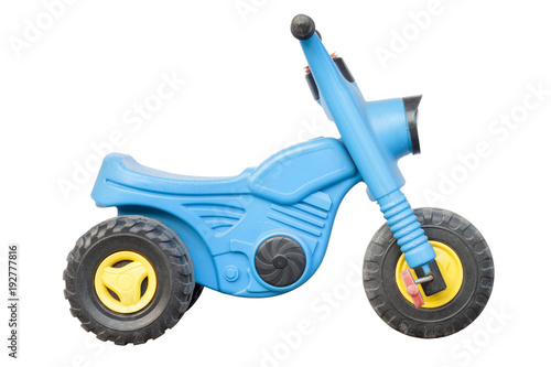 Fotografia Blue plastic motorcycle toy for children study first control bike on white background