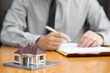 Consumer fill in the home loan application form for pending approval from the bank