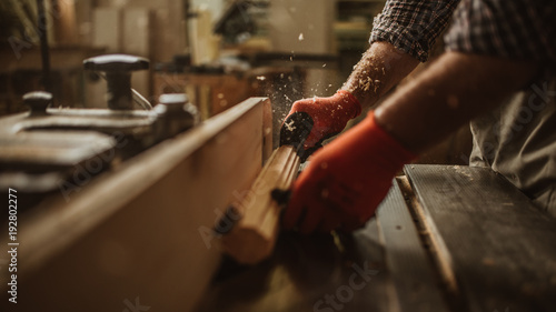 Valokuva carpenter works with manual and electric equipment