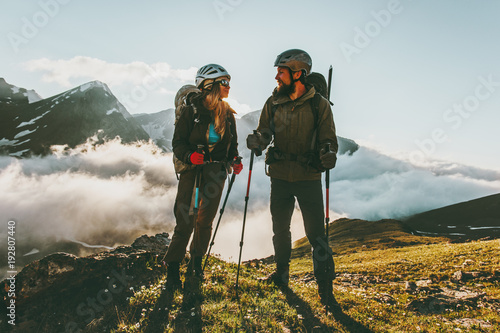 Fototapeta Travel Couple backpackers man and woman hiking in mountains love and adventure Lifestyle wanderlust concept. obraz na płótnie