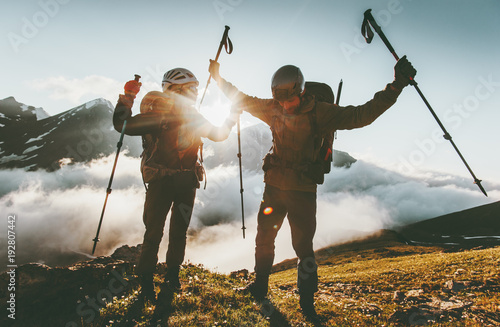 Obraz Happy travel couple man and woman on mountain summit love and adventure hiking Lifestyle wanderlust concept sunset light. - fototapety do salonu