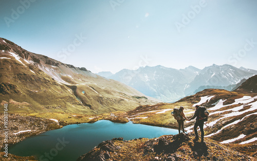 Poster Camping Couple travelers holding hands on mountain cliff over lake together love and Travel Lifestyle wanderlust concept adventure vacations outdoor aerial view.