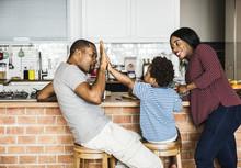 Black Family Spending Time Tog...