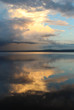 Sunset and clouds reflected in Orsa lake.