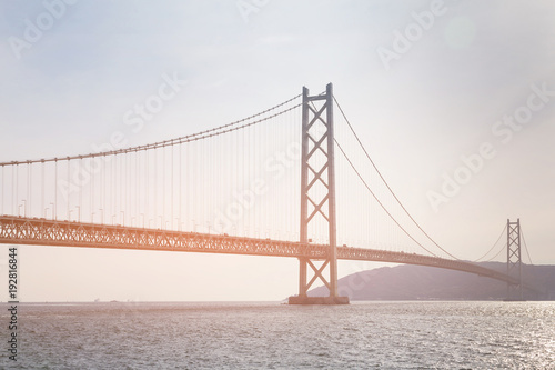 фотография  Akashi suspension bridge crossing sea coast, Japan longest bridge Kobe
