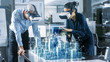 canvas print picture - Male and Female Architects Wearing  Augmented Reality Headsets Work with 3D City Model. High Tech Office Professional People Use Virtual Reality Modeling Software Application.