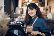 asian woman barista making hot coffee with machine at counter bar in cafe restaurant,Food and drink service concept