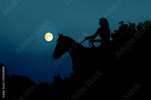 Full moon with silhouette of the horse rider on sky, concept in Fantasy World Poster
