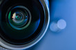 canvas print picture - The camera lens and blue backlighting . Horizontal photo