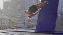 Professional Gymnast Jumping O...