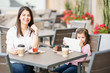 Mother and daughter at cafe