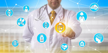 Doctor Remotely Tacking Pulse In Clinical Trial