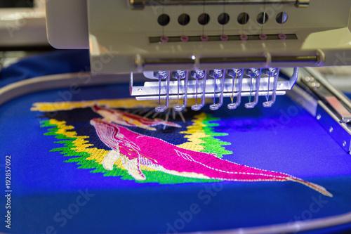 Obraz na płótnie Professional machine for applying embroidery closeup