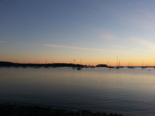 Sunrise In Maine With Clouds A...