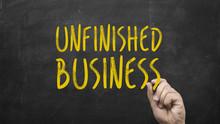 Unfinished Business Written On Chalkboard