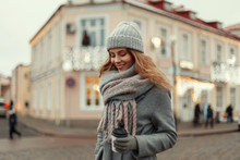 Beautiful Happy Young Girl With A Smile In Fashionable Knitted Clothes With A Glass Of Coffee Traveling In The City In The Winter Vacation