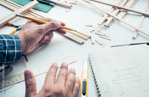 Photo  Male working on worktable with balsa wood material