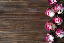 Roses Frame On Wooden Brown Background