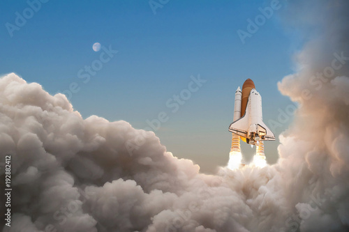 Fotografie, Obraz  Space Shuttle starts its mission and takes off into the sky