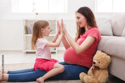Play clapping hands together with mom