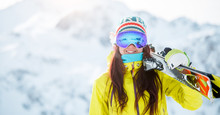 Image Of Woman With Skis On He...
