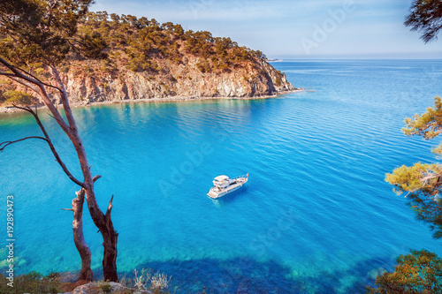 Crédence de cuisine en verre imprimé Bleu Picturesque scenery of coastline of Turkey on Mediterranean sea. Solitary luxury white yacht in the incredible bay. Summer vacation background. Location Antalya Turkey.