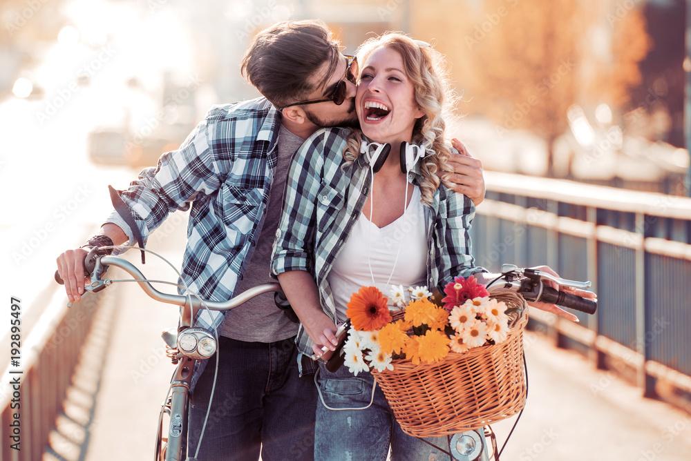 Fototapeta Happy couple in city with bike