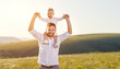 Father's day. Happy family father and toddler son playing and laughing on nature at sunset