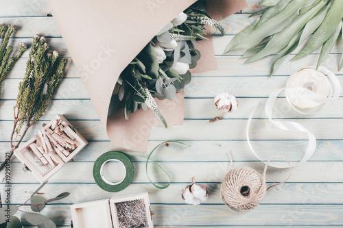 Foto op Canvas Bloemen Florist workplace with flower on wooden background