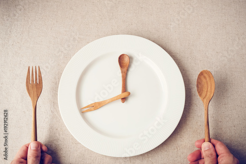 Fotomural  white plate with spoon and fork, Intermittent fasting concept, ketogenic diet, w