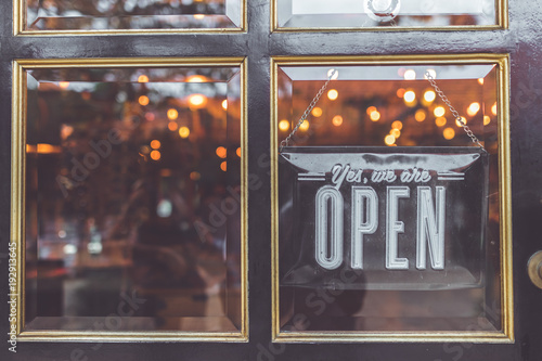 Open vintage sign broad through the glass of store window. Asia. Canvas-taulu