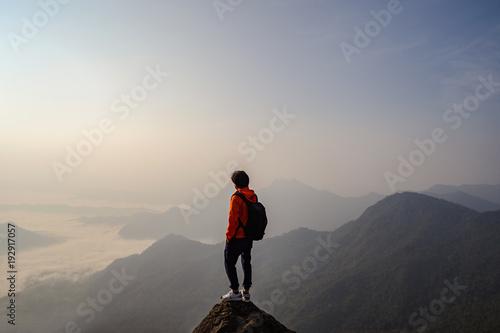 Aluminium Prints Dark grey Young traveler standing and looking at beautiful landscape