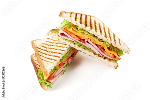 Poster de jardin Snack Sandwich with ham, cheese, tomatoes, lettuce, and toasted bread. Above view isolated on white background.